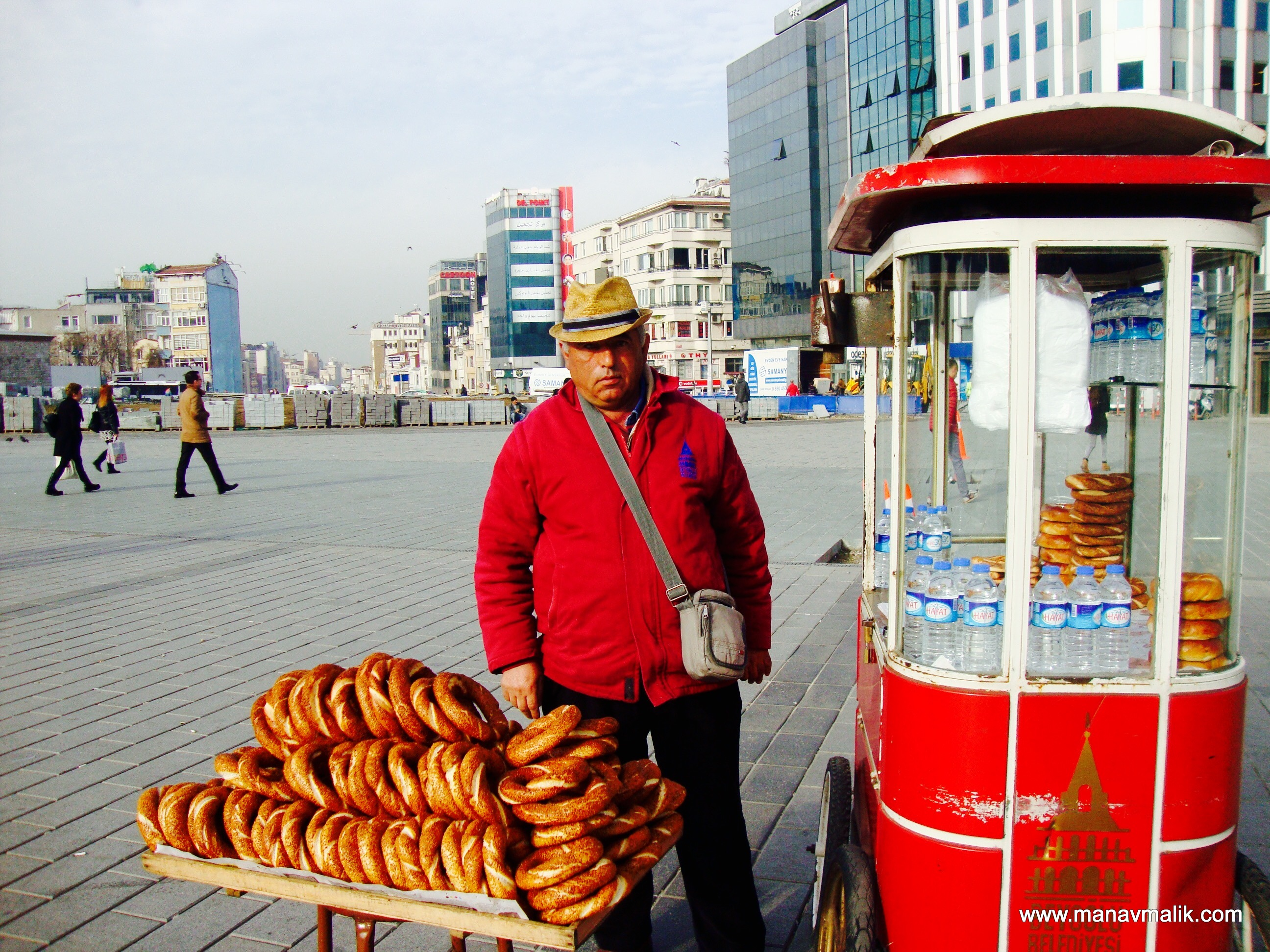 A vendor selling Simits or sesame breads